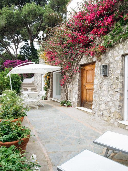 Mediterranean Side Yard Stone Patio Container Garden Idea In Naples