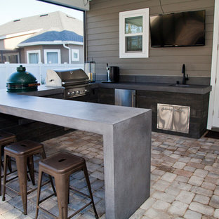 Inspiration for a mid-sized modern backyard brick patio kitchen remodel in Jacksonville