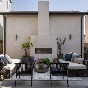 Patio - contemporary concrete patio idea in Orange County