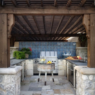 Photo of a mediterranean patio in Wichita with an outdoor kitchen.