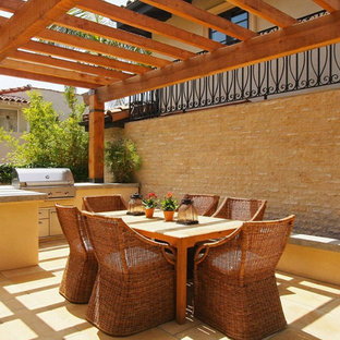 Patio - mediterranean patio idea in Los Angeles with a pergola
