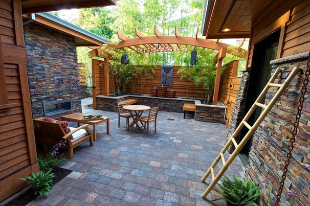Eclectic Patio by Stone Bridge Homes NW