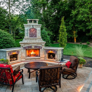 Example Of A Clic Brick Patio Design In Other With Fire Pit