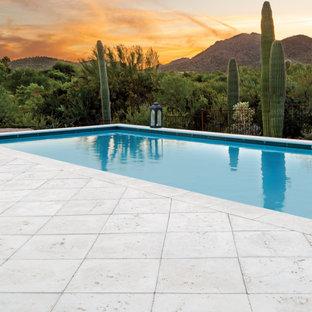 Foto di un patio o portico american style con pavimentazioni in cemento