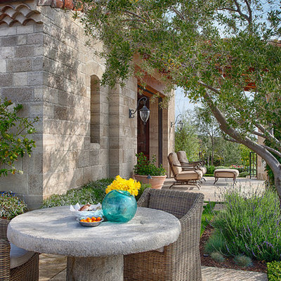 Tuscan patio photo in Orange County with no cover