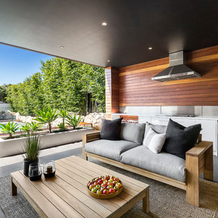Inspiration for a contemporary backyard patio in Melbourne with an outdoor kitchen and a roof extension.