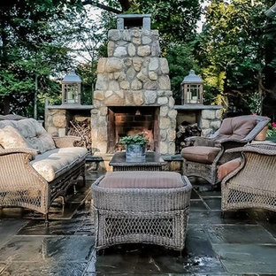 Inspiration for a mid-sized craftsman backyard stamped concrete patio remodel in New York with a fire pit and no cover