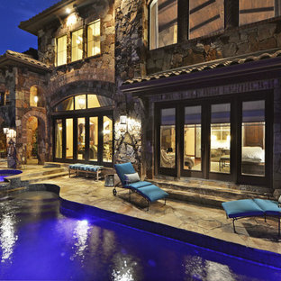 Inspiration for a mediterranean front yard stone patio fountain remodel in Austin with no cover