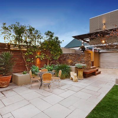 Inspiration for a mid-sized contemporary patio remodel in Melbourne with no cover