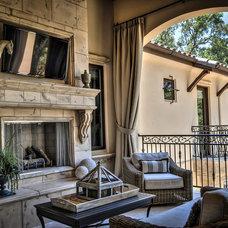 Rustic Patio by Anne Sacco Interiors, LLC