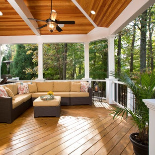 Example of a large classic backyard patio design in DC Metro with decking and a roof extension