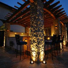 Tropical Patio by Environmental Landscape Associates