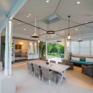 Design ideas for a large contemporary courtyard patio in Sydney with a roof extension and concrete pavers.