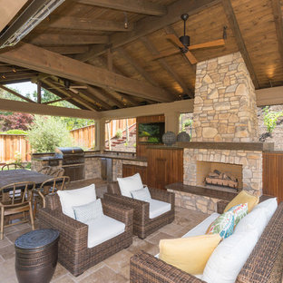 Patio - large craftsman backyard stone patio idea in San Francisco with a pergola and a fire pit