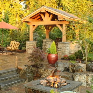 Traditional patio in Seattle with a pergola.