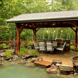 Example of a trendy backyard patio fountain design in Seattle