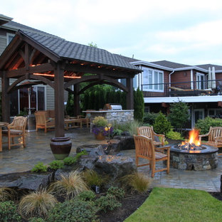 Inspiration for a timeless patio remodel in Seattle with a fire pit and no cover