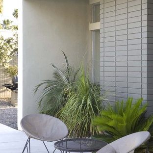 Patio - modern patio idea in Los Angeles with a fire pit
