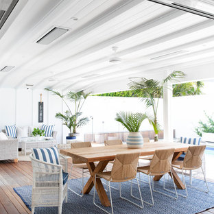 Photo of a large beach style backyard patio in Gold Coast - Tweed with a roof extension and decking.