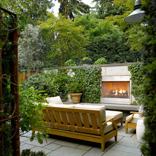 Inspiration for a contemporary backyard stone patio remodel in Seattle with a fire pit and no cover
