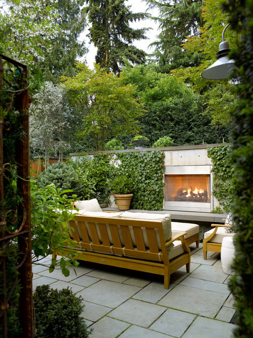 Inspiration For A Backyard Stone Patio Remodel In Seattle With A Fire Pit