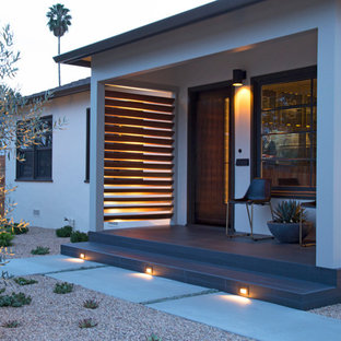 Inspiration for a large modern front yard concrete patio kitchen remodel in San Luis Obispo with a pergola