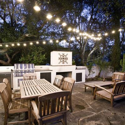 Patio - mid-sized contemporary backyard stone patio idea in Los Angeles with no cover