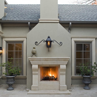 Inspiration for a mediterranean courtyard patio remodel in Dallas with a fire pit