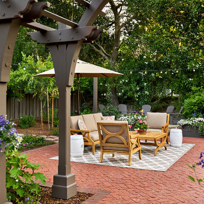 Example of a huge classic backyard brick patio design in San Francisco with a pergola