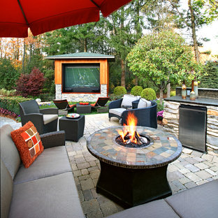 Inspiration for a contemporary backyard brick patio remodel in Detroit