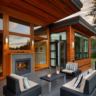 Trendy patio photo in Vancouver with a fire pit