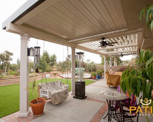 Minimalist Backyard Concrete Patio Photo In Orange County With A Pergola