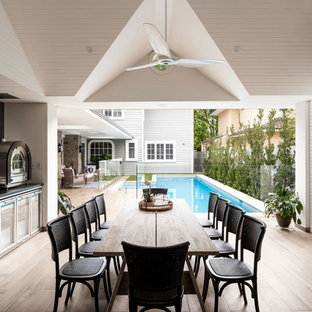 Traditional backyard patio in Perth with an outdoor kitchen, decking and a roof extension.