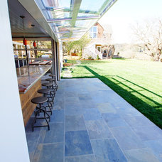 Contemporary Patio by Cairn Construction Inc.