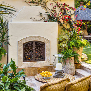 Mid-sized tuscan backyard patio photo in Santa Barbara with a fire pit and no cover