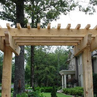 Idee per un patio o portico con una pergola