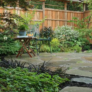 Foto di un patio o portico etnico di medie dimensioni