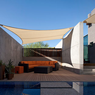 Patio - mid-sized contemporary backyard patio idea in Phoenix with decking and an awning