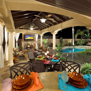 Large mediterranean back patio in Los Angeles with an outdoor kitchen, concrete slabs and a gazebo.