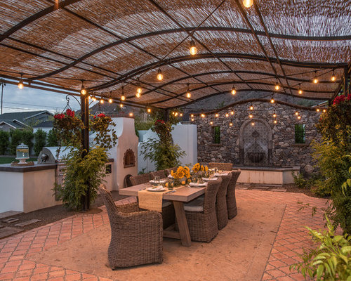 Inspiration For A Large Mediterranean Backyard Patio Fountain Remodel In  Phoenix With An Awning