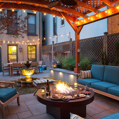 Transitional backyard patio photo in San Francisco with a fire pit and a gazebo