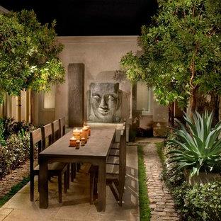 Immagine di un patio o portico etnico con nessuna copertura