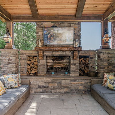 Mountain style patio photo in Nashville with a roof extension and a fireplace
