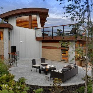 Ejemplo de patio contemporáneo con suelo de hormigón estampado