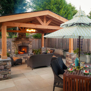 Inspiration for a timeless backyard patio remodel in Portland with a gazebo and a fire pit