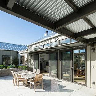 Inspiration for a farmhouse patio remodel in San Luis Obispo with no cover