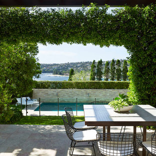 Inspiration for a contemporary patio in Sydney with a pergola.