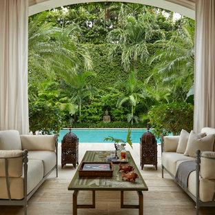 Photo of an asian backyard patio in Miami.