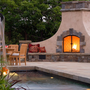 Tuscan patio photo in San Francisco with a fire pit