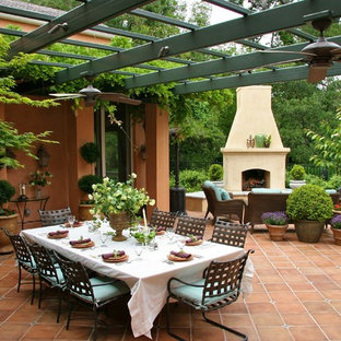 Tuscan patio photo in Sacramento with a fire pit and a pergola